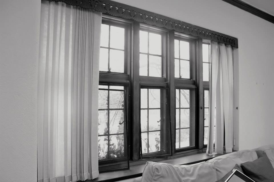 Black and white interior photograph of the windows of Perry House.
